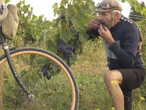 A participant in L'Eroica stops for a mid-ride snack