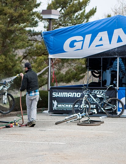 Team mechanic Justin Morse cleans one of his riders' bikes