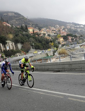 The peloton race along the coast under grey skies during Milan-San Remo on Saturday