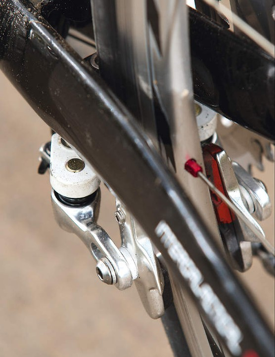 Positioning of the rear brake with its  grub screw-secured cable block is awkward to adjust