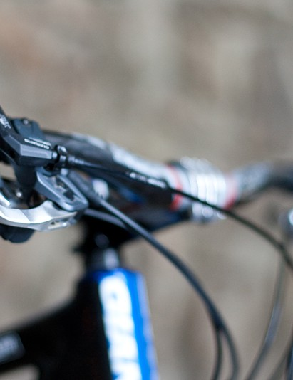 The Fox Racing Shox remote lockout lever is tucked neatly next to the Shimano XTR shifter