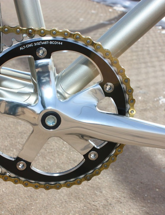 The polished alloy crank is fitted with a 46T chainring