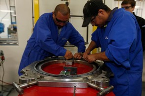 Workers lay pre-cut pieces of raw composite material into a mold  Contrary to popular belief, high-end carbon fiber production in incredibly labor-intensive - and expensive  Easton says each Haven Carbon rim costs over ten times more to produce than an alloy one