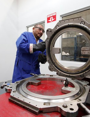 Workers open up one of the clamshell molds to remove a newly created Haven Carbon rim