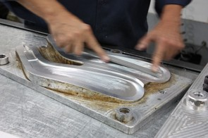 Easton's hockey stick molds, on the other hand, are machined with a conventional mill and require polishing and filing to remove the milling artifacts