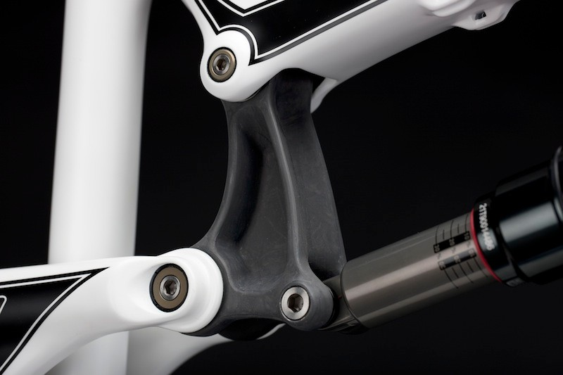 The upper link is compression moulded carbon fibre, again, mounted with titanium hardware.