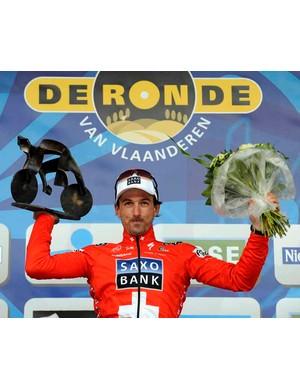 Fabian Cancellara on the podium with his loot