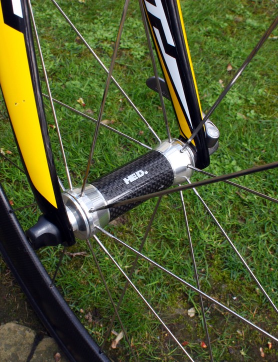 HED's 'Flamme Rouge'-edition front hubs feature a carbon fibre centre section to shave a few grams.