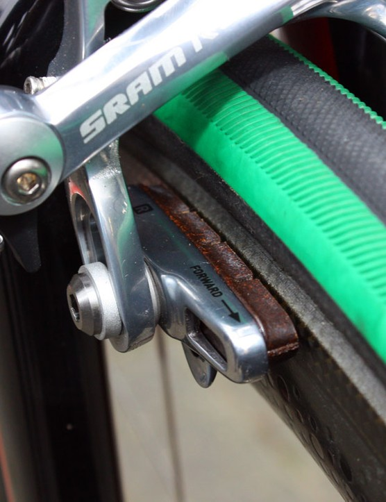 The SRAM Red cartridge holders are filled with older Shimano carbon-specific brake blocks.