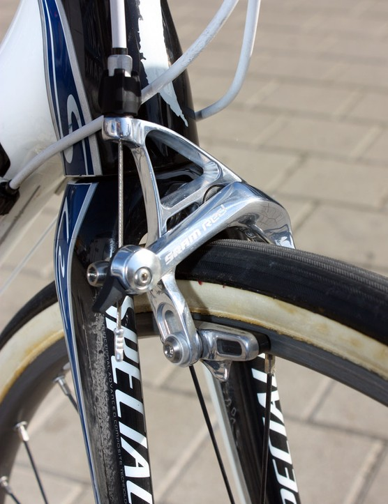 The maxed-out brake pad adjustment on Breschel's SRAM Red calliper reveals the extra tyre clearance underneath the fork crown.