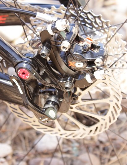 X0 brake caliper, with a 1070 cassette in the background.