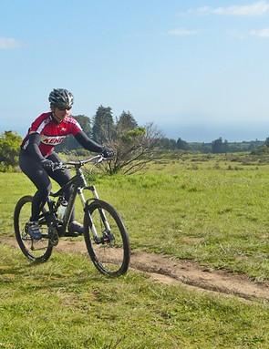 Sue George riding the Nickel across Wilder Ranch trails in Santa Cruz, in view of the ocean