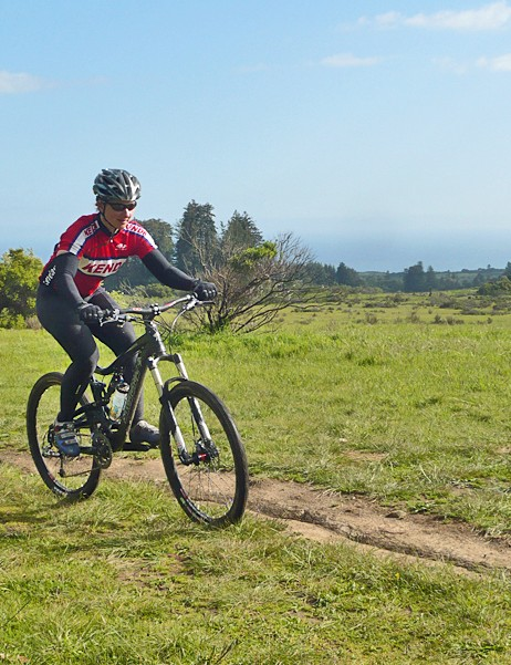 Sue George riding the Nickel across Wilder Ranch trails in Santa Cruz, in view of the ocean