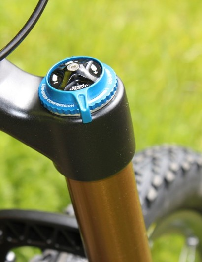 The familiar top cap of the FIT RLC damper, which features adjustments for low-speed compression, lockout threshold and the lockout lever