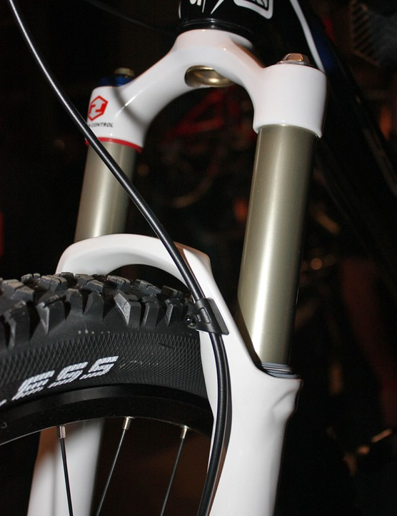 Finally!  RockShox has ditched zip-ties with this clean-looking proper clamp on the revised arch.