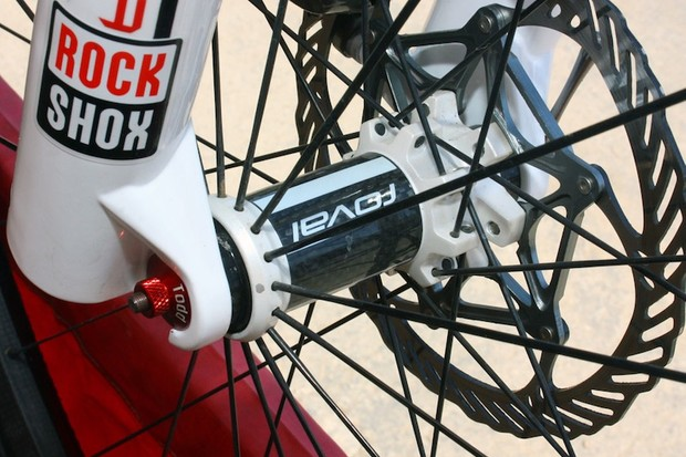 The front hub bears the usual Roval trademarks, including 2:1 spoke lacing, a carbon fiber center section, and straight-pull spokes.