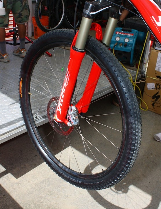 Specialized factory team riders were spotted in the pits with new carbon-rimmed wheelsets.