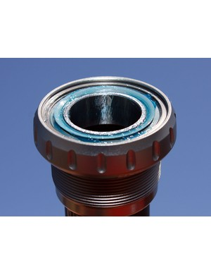The Gutter lip is built into the outer cartridge bearing seal and presses directly against the nylon faceplate.