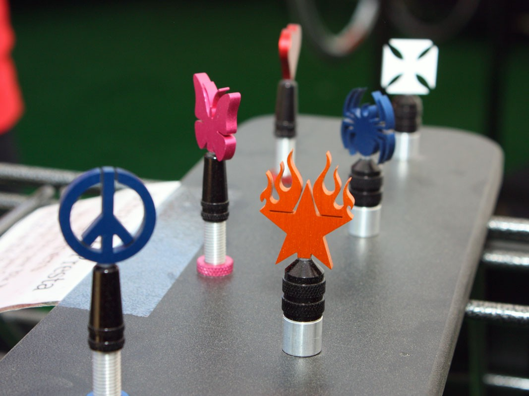 Purely Custom's Spinner valve caps include a machined alloy base plus an additional freely rotating flag at the top