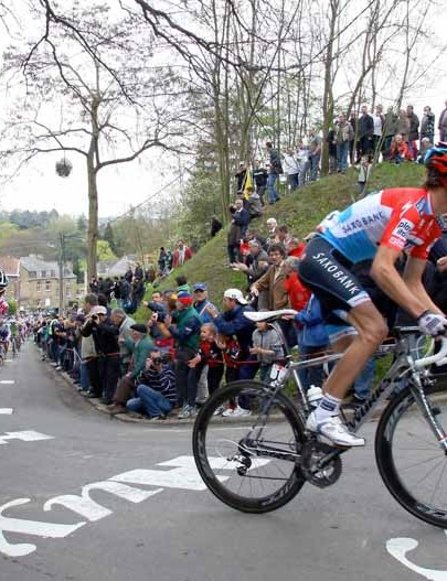 Andy Schleck leads Philippe Gilbert and Alberto Contador on the Mur de Huy