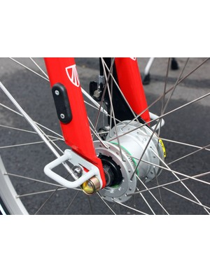 B-cycles are locked into the stations with the two loops on either side of the fork tips.  Theft-resistant nuts are used to secure the wheels and an integrated RFID chip lets each station identify specific bikes.