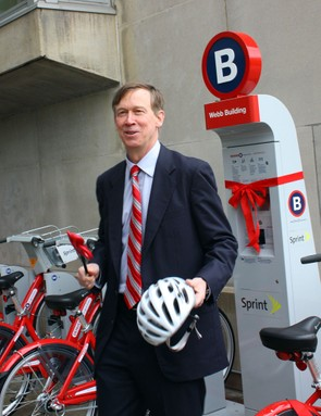 Denver mayor John Hickenlooper heads towards his waiting B-cycle after the ribbon-cutting ceremony.
