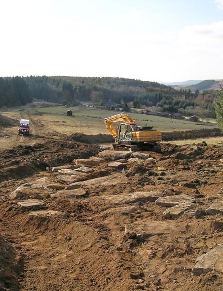 Dirt jumps and rock garden take shape
