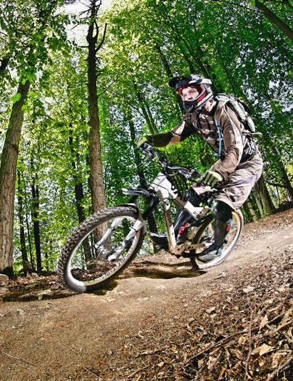 The singletrack weaves a testing trail  through  the forest