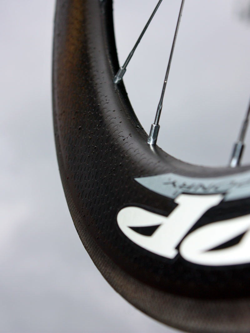 The unusual 'Firecrest' rim shape is very wide at the tire (25.5mm) but even wider closer to the spoke bed (27.5mm).  The large-radius nose is also said to produce lower drag figures at a wider range of yaw angles.