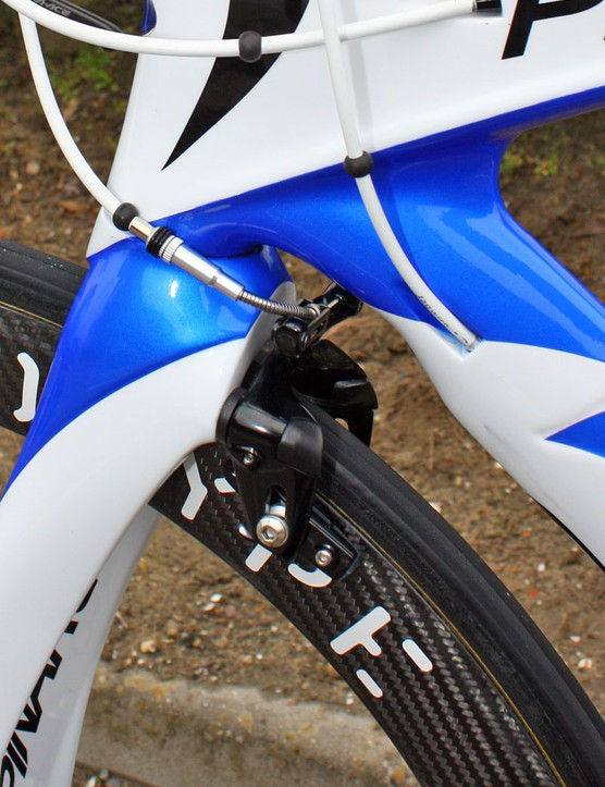The front brake is tucked in behind the bulbous fork crown
