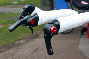 Cofidis time trial bikes were fitted with these carbon fibre-wrapped bar-end shifters from microSHIFT