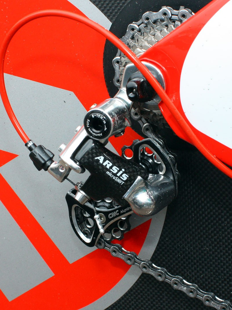 The microSHIFT ARSiS rear derailleur is built with a carbon-wrapped outer plate and cage