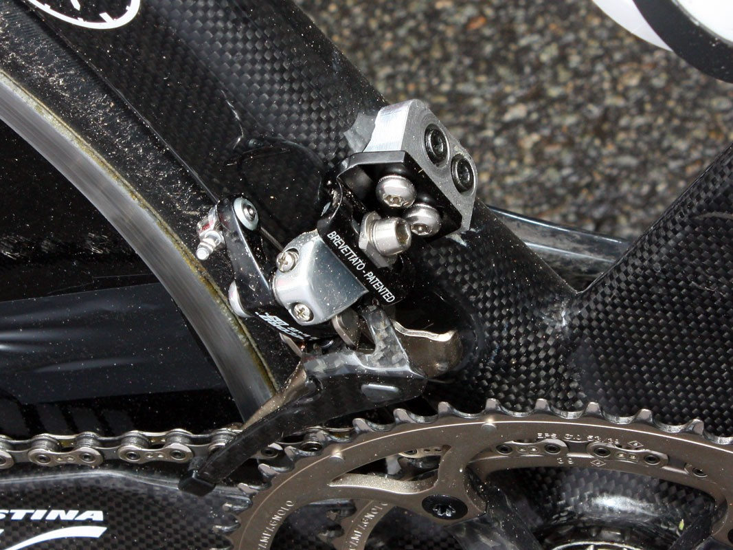 The alloy block on this Lampre-Farnese Vini front derailleur mount looks somewhat out of place but is apparently required to achieve the proper position