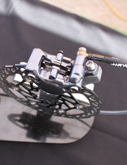 The Prime Pro features a two piece calliper that's finished with titanium and alloy hardware