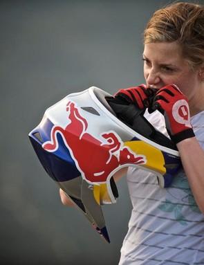 Rachel Atherton adjusts her helmet strap