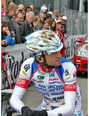 Androni Giocattoli-Diquigiovanni captain Michele Scarponi protects his head with a custom painted Selev helmet