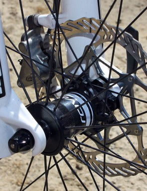 The front hub features interchangeable end caps that work with standard quick-release or 15/20mm through-axle dropouts
