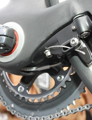 The rear V-style brake is fully integrated but not captured within the frame making the mechanic's job much easier.