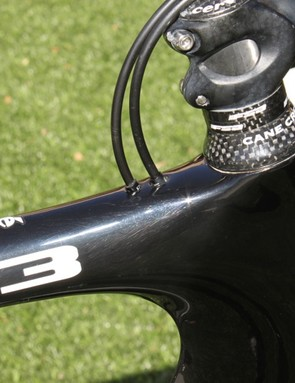 The S3 has a revised cable routing through the top of the top tube; cable housing stops there and the cables run through nylon lined stainless steel tubes to their exit points.