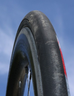 The wider rim is optimized for more realistic tire sizes.  Larger radius edges reduce the occurrence of pinch flats