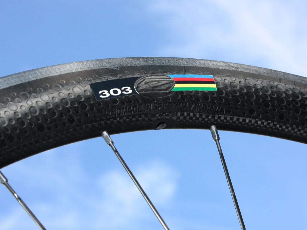 Zipp claims the dimpled surface reduces aerodynamic drag relative to a smooth one