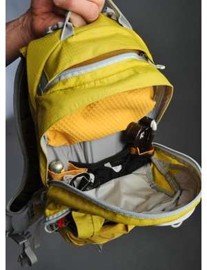 The main pocket includes sleeves for tools and parts while also easily swallowing jackets, warmers and other pieces of clothing