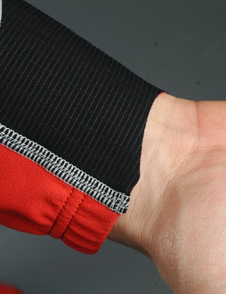Asymmetrically cut cuffs seal reasonably well and are very comfortable on your wrists