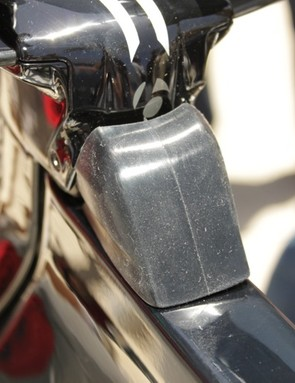 The brake and shifter cables exit the back of the stem into the top tube and are protected by a rubber cover