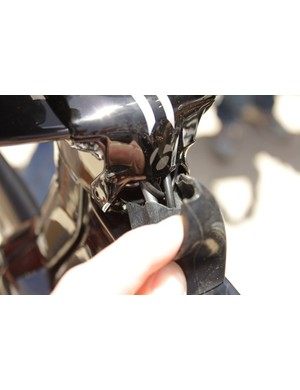 The rubber cover is meant to keep excessive water and grit out of the frame, but moves easily when steering the bike