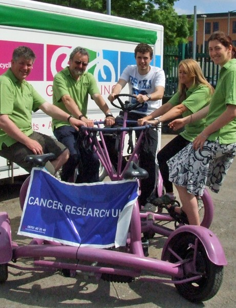 Cancer Research UK supporters are pedalling from Land's End to John O'Groats on a seven-seater 'ConferenceBike'