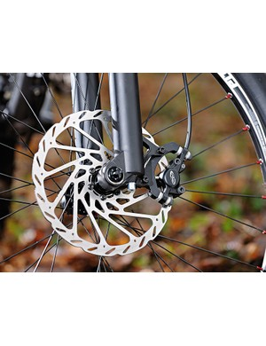 A big 203mm disc and through-axle fork keep things burly at the front end