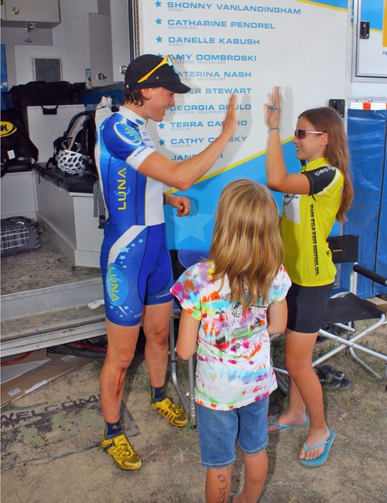 Georgia Gould (Luna) high-fives a young fan after winning her race at the Mellow Johnny's Classic