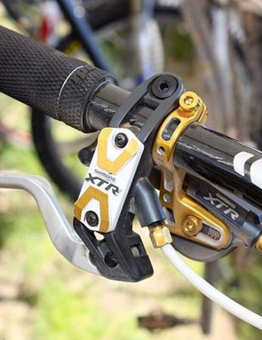 Adam Craig's (Rabobank-Giant Off-Road Team) controls get the gold treatment courtesy of Shimano's Yumeya hop-up parts