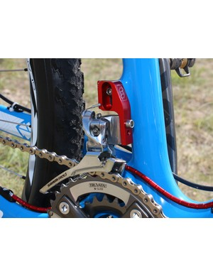 The steel-caged SRAM Red road front derailleur is adapted for use on the direct-mount frame with a custom mount made by a high-end automobile importer in New York.